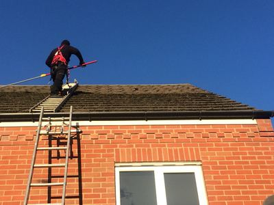 Softwash Roof Cleaning in Progress