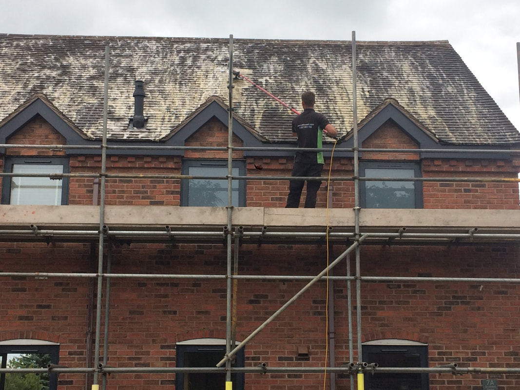 Softwashing a roof in Walsall
